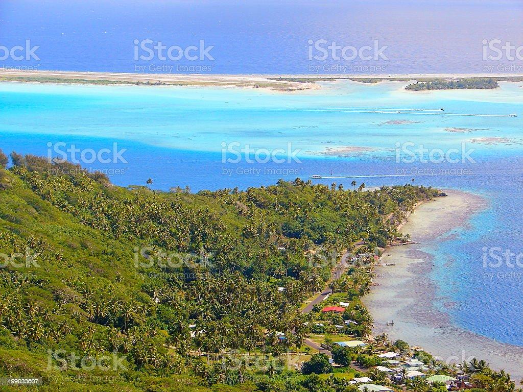 Above Bora Bora coastline: Palm trees & turquoise sea, Polynesia royalty-free stock photo