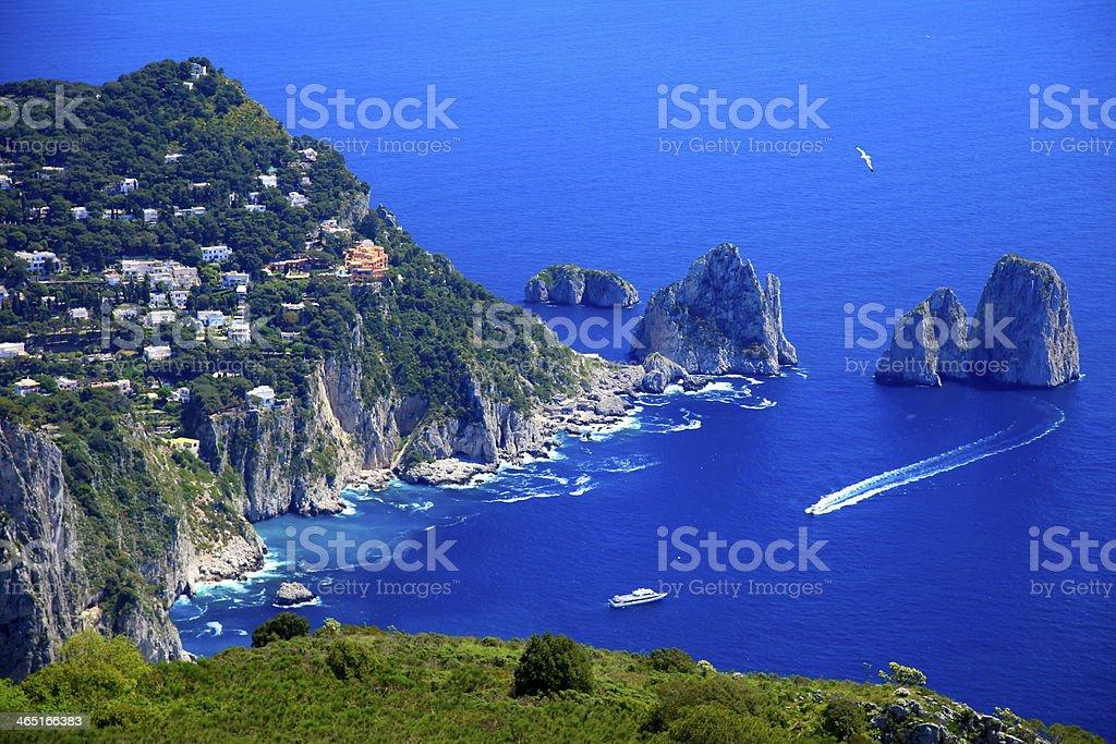 Above Capri Island boats and Faraglioni - Blue mediterranean, Italy stock photo