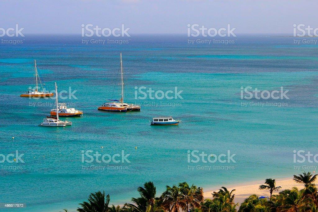 Above Caribbean paradise panorama! Turquoise palm beach, ships – Aruba, Antilles stock photo