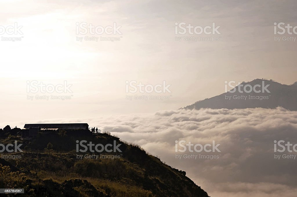 Above clouds with a mountain volcano view stock photo