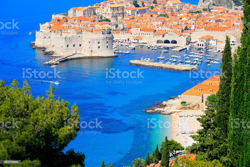 Above Dubrovnik old town with turquoise mediterranean adriatic beach, Croatia stock photo