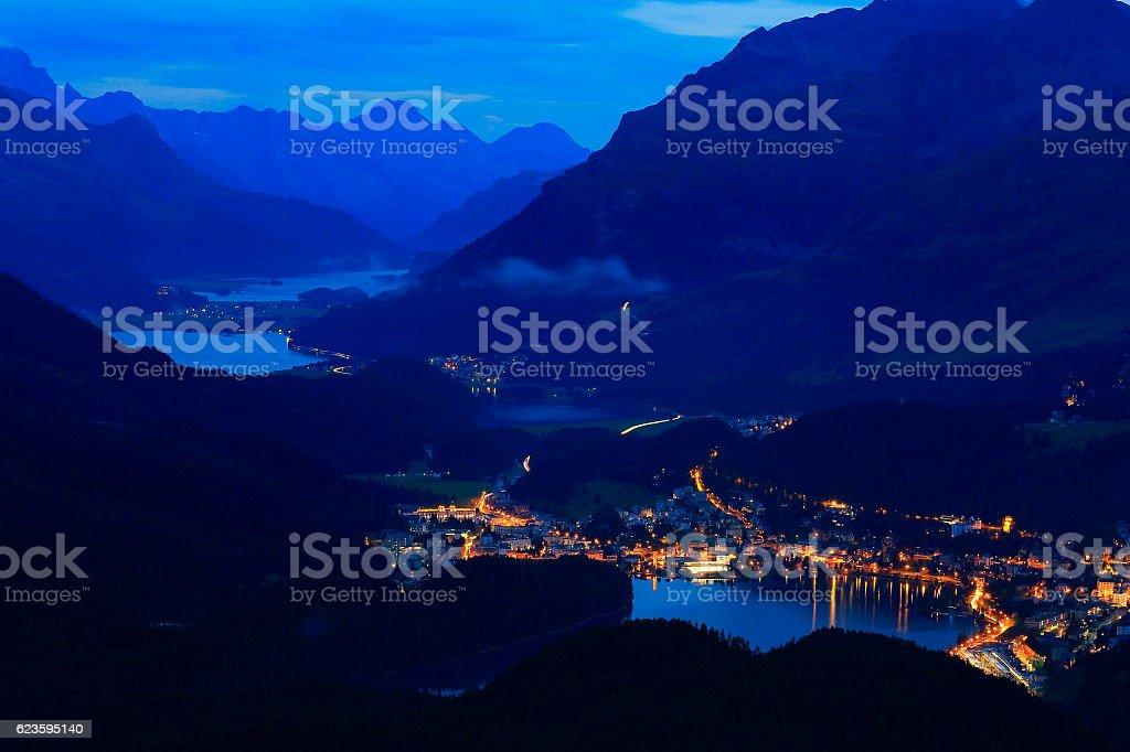 Above Engadine, St Moritz cityscape lights, lakes evening, Swiss Alps stock photo