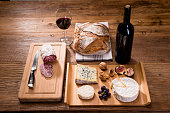 above flat lay cheese tray red wine appetizer wooden background