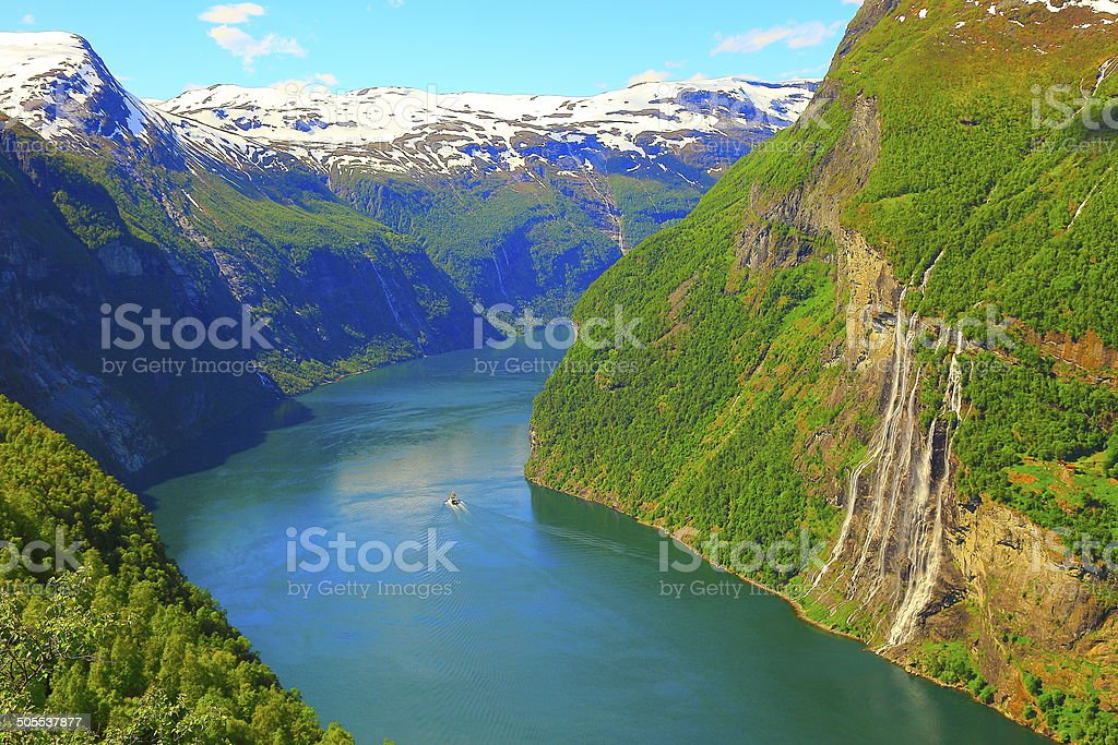 Above Geiranger Fjord boat and Seven Sisters Waterfall, Norway stock photo