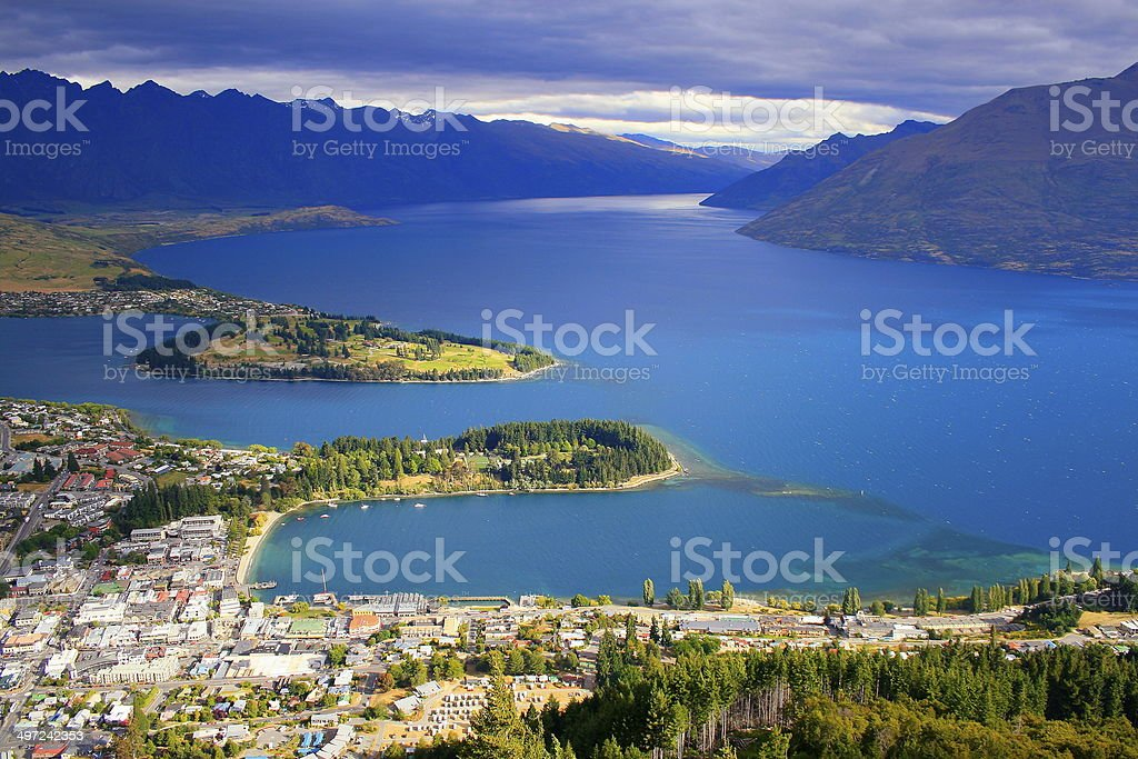 Above Queenstown dramatic sunset sky and Remarkables - New Zealand stock photo
