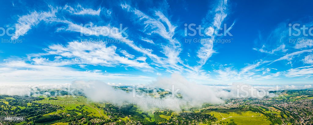 Above the clouds panorama aerial view over country villages farms stock photo
