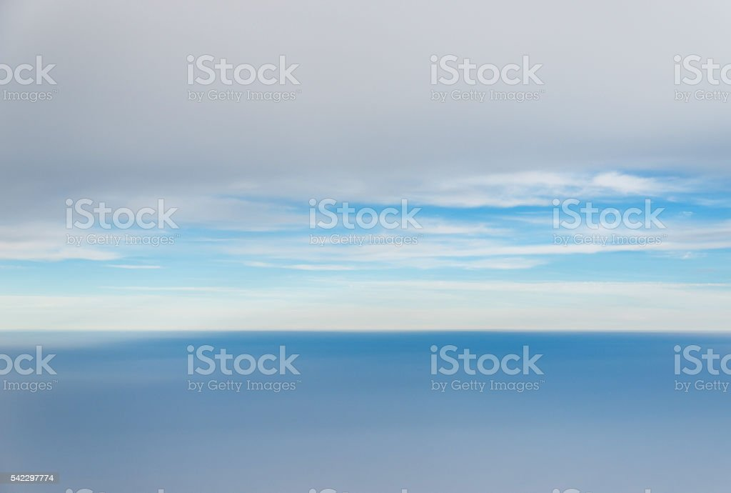 Above the clouds view from an airplane stock photo