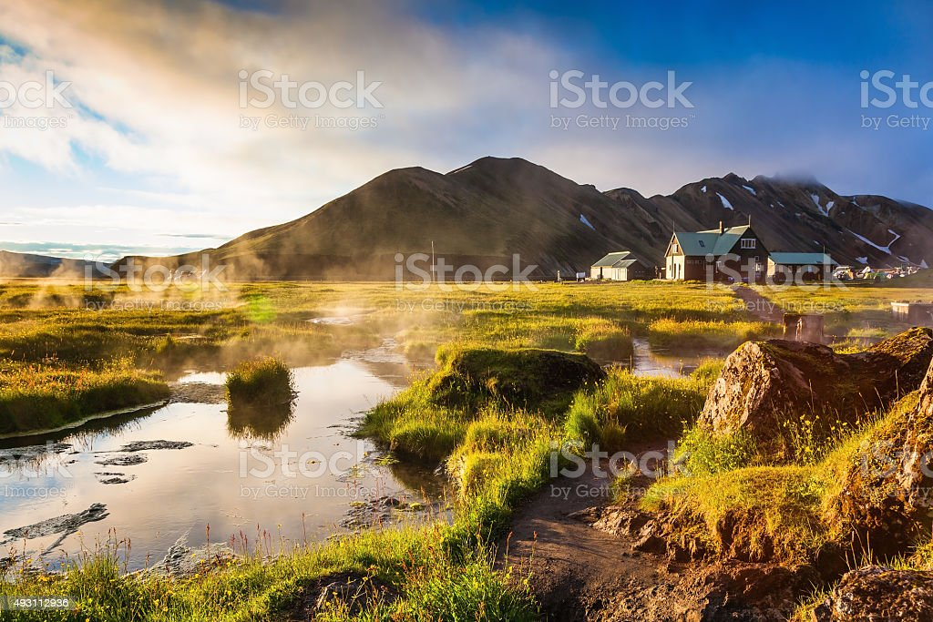 Above the source of thermal water steam rises stock photo