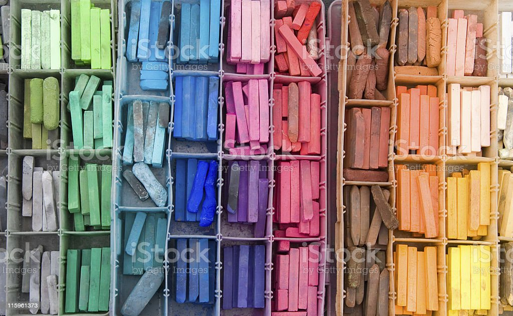 Above view of a divided box filled with a rainbow of pastels royalty-free stock photo