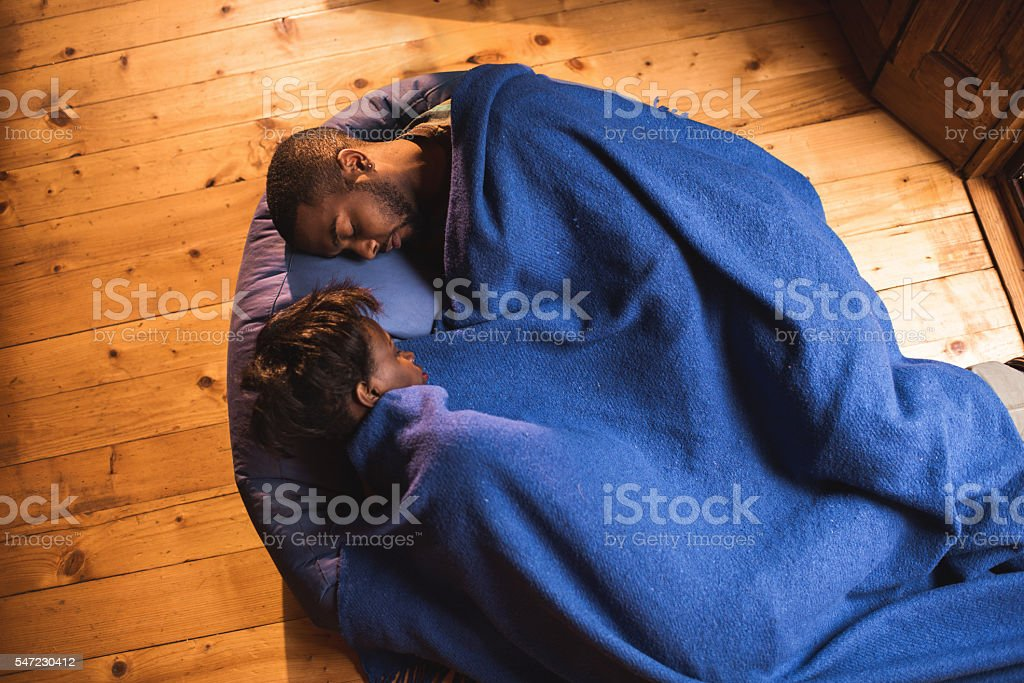 Above view of African American couple sleeping on bean bag. stock photo
