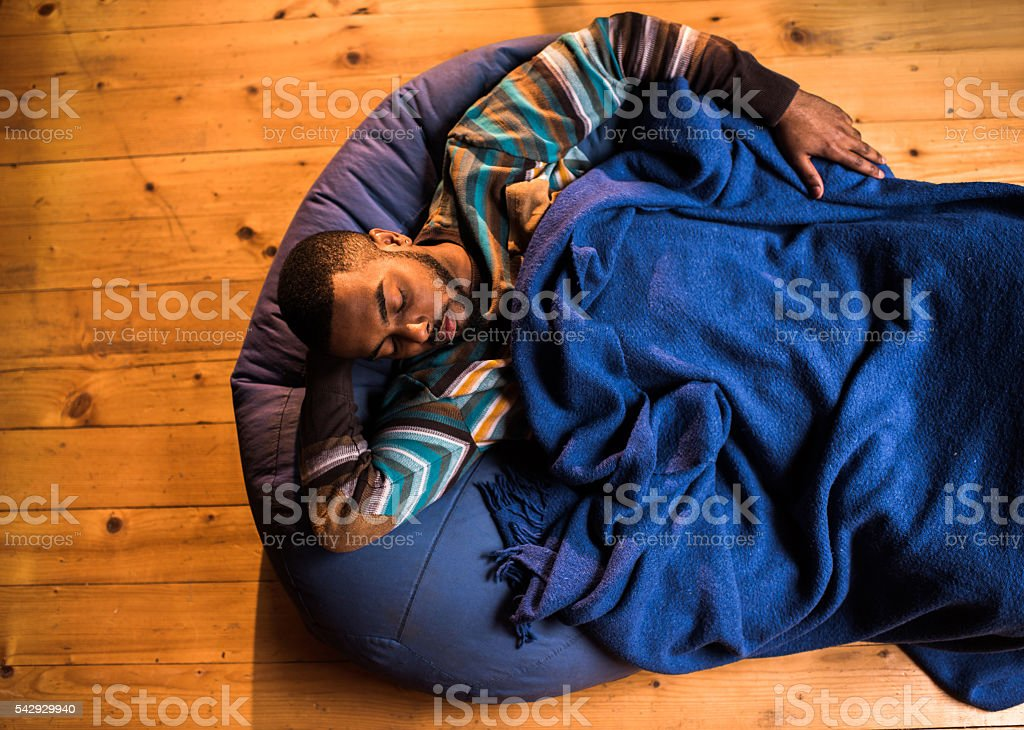Above view of African American man taking a nap. stock photo