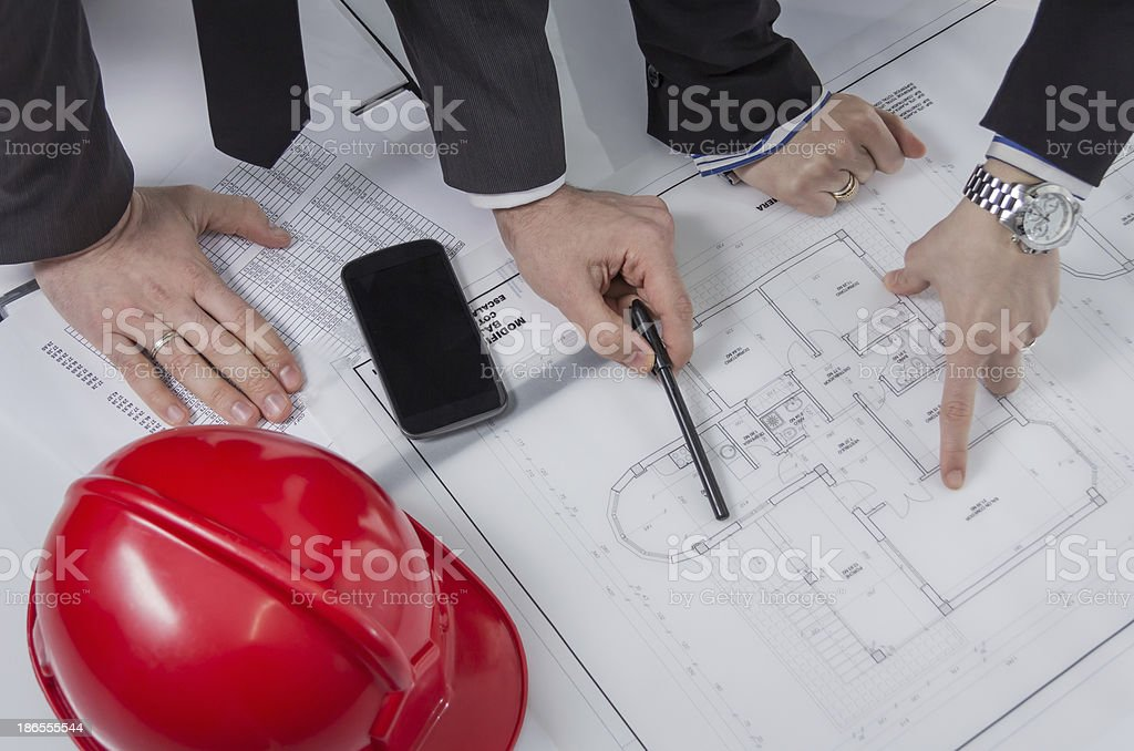 Above view of architects hands revising a house project royalty-free stock photo