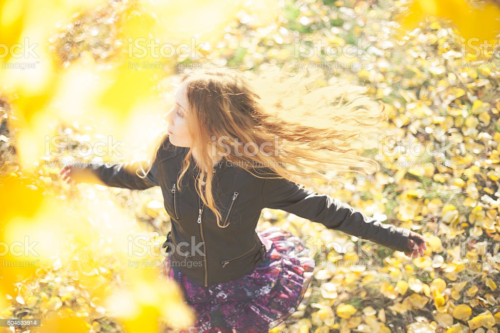 Above view of beautiful girl running in autumn park stock photo