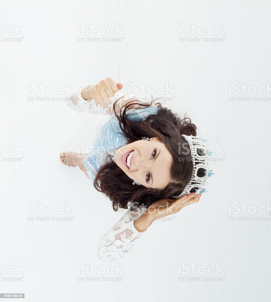Above view of beauty queen cheering stock photo