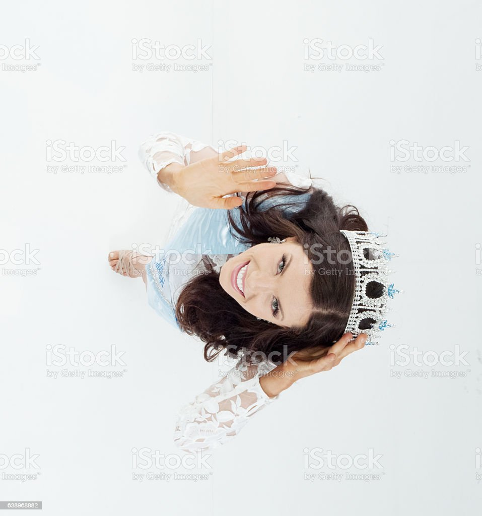 Above view of beauty queen waving hand stock photo
