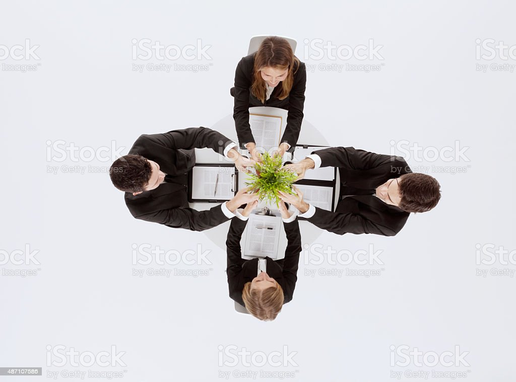 Above view of business colleges in a meeting stock photo