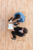 Above view of business people doing teamwork