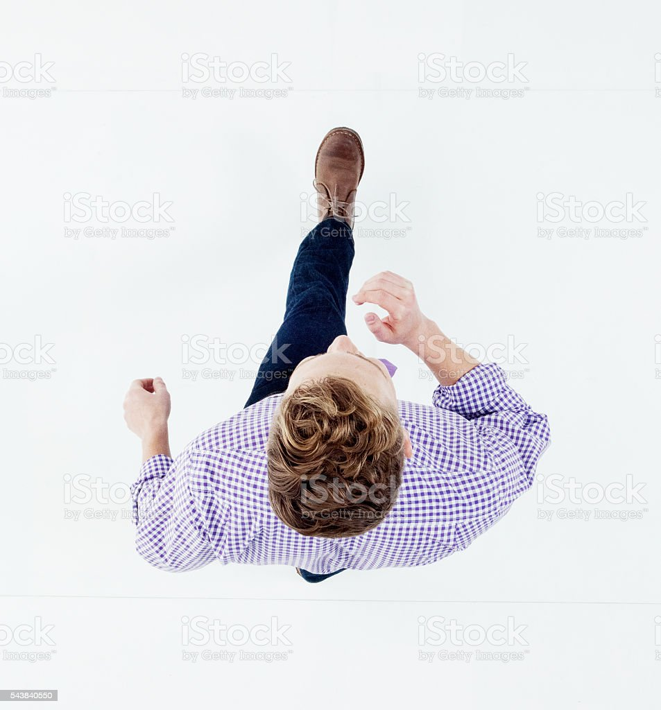 Above view of businessman walking stock photo