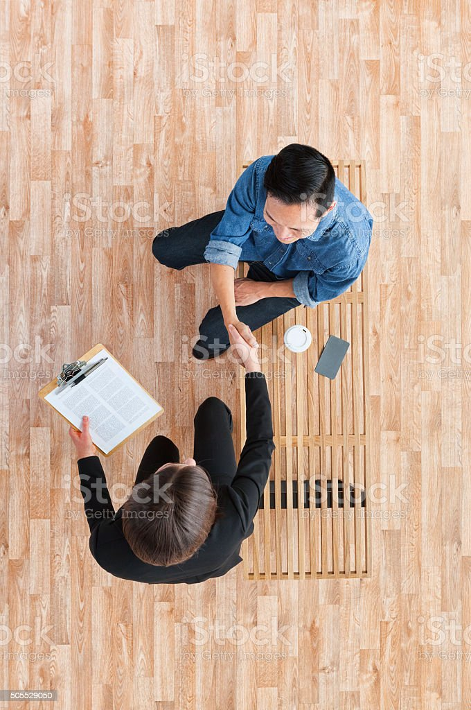 Above view of businesswoman giving handshake stock photo