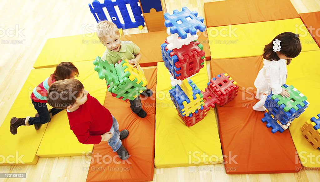Above view of children stacking blocks. royalty-free stock photo