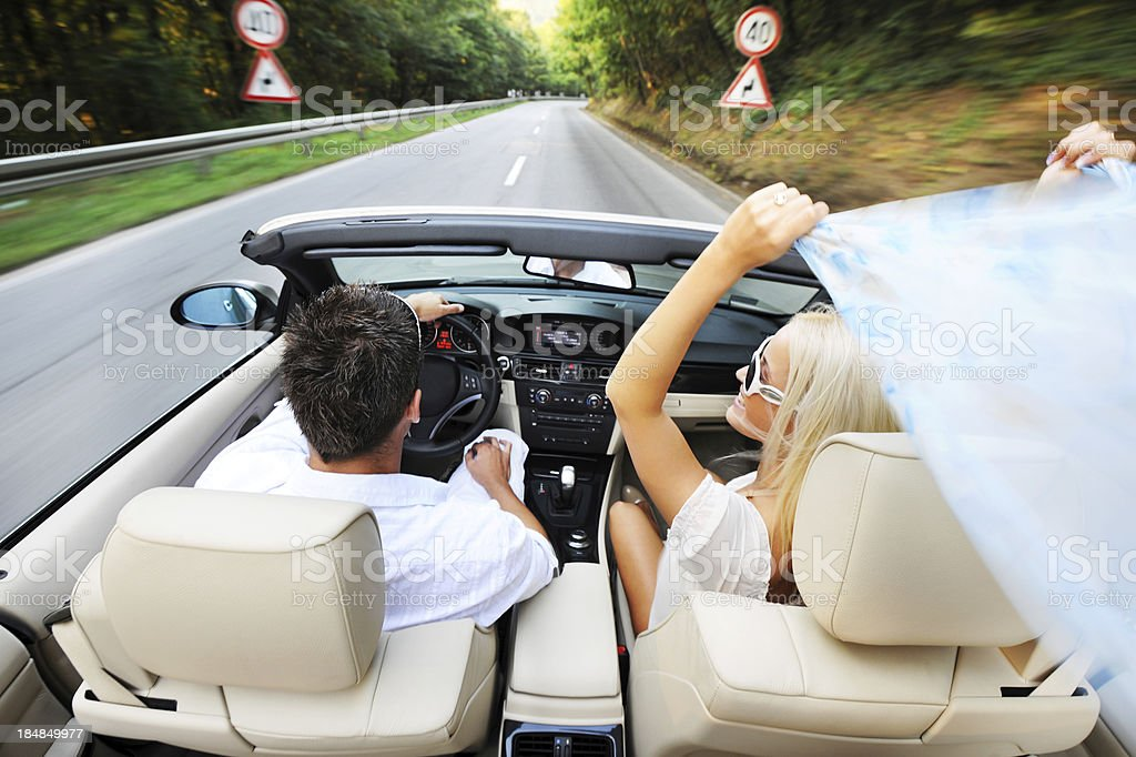 Above view of couple driving in a car. stock photo