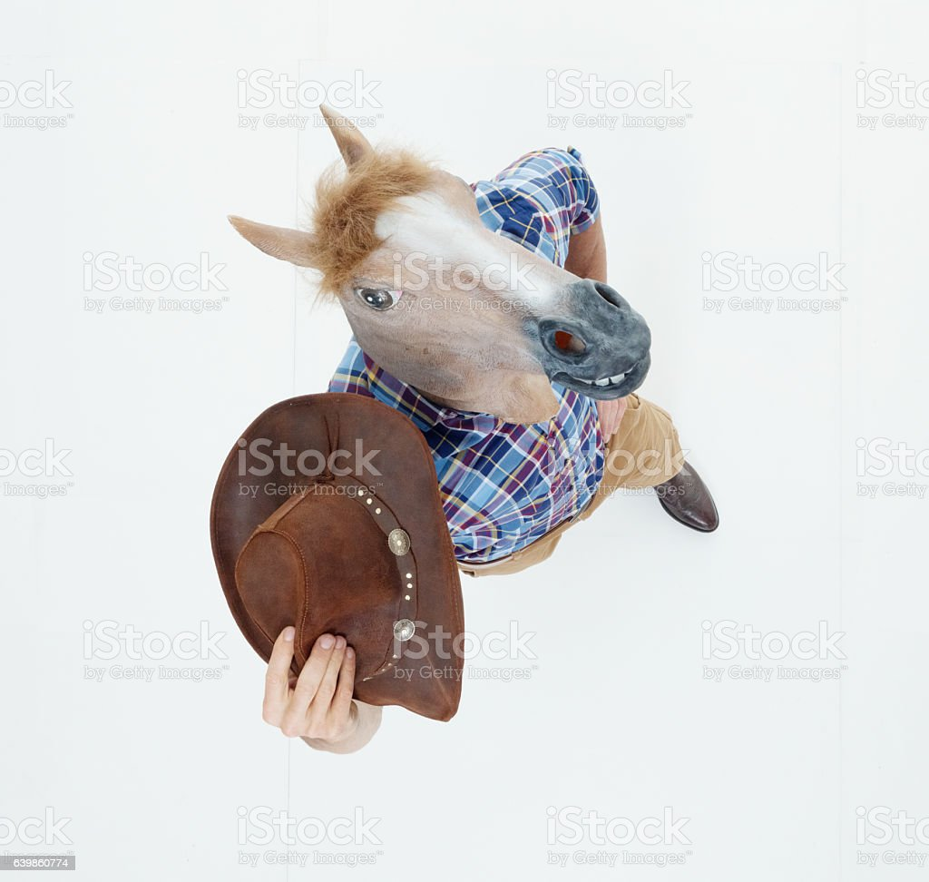 Above view of cowboy in horse costume stock photo