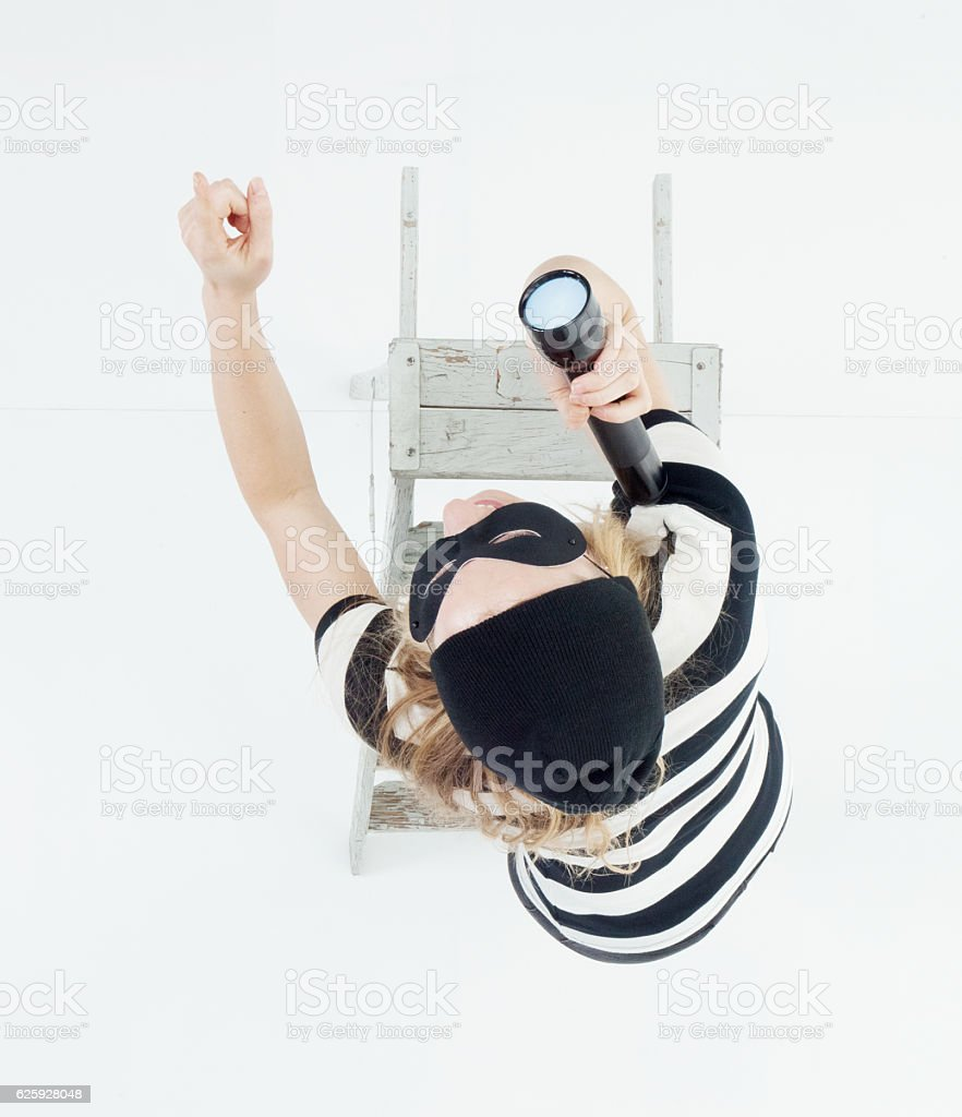 Above view of female burglar pointing stock photo
