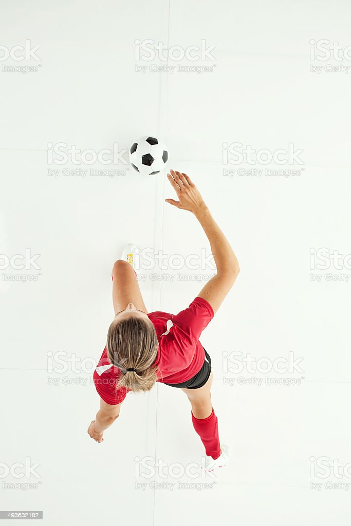 Above view of female soccer player playing stock photo