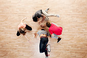 Above view of friends breakdancing