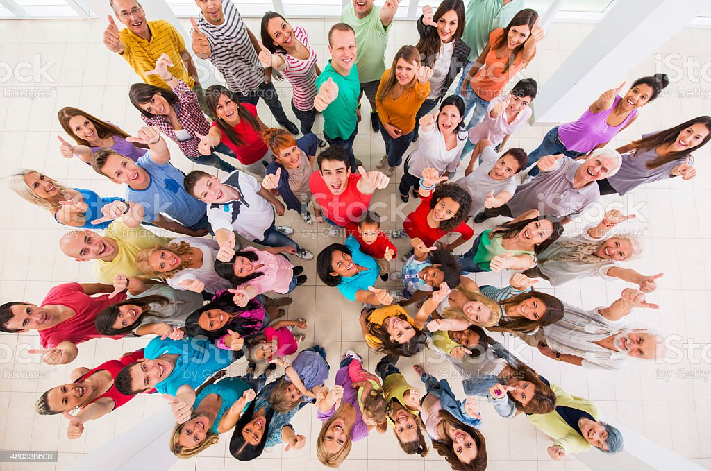 Above view of group of happy people showing thumbs up. stock photo