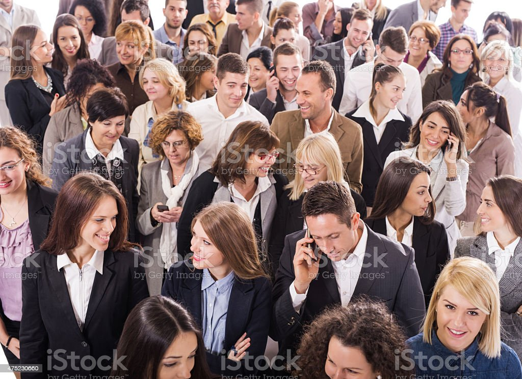 Above view of group of multi-tasking business people. stock photo