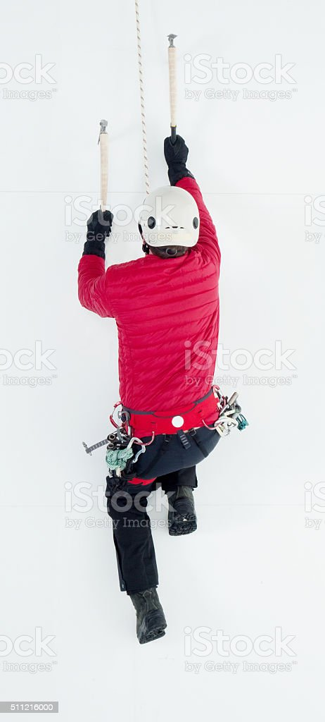 Above view of ice climber in action stock photo