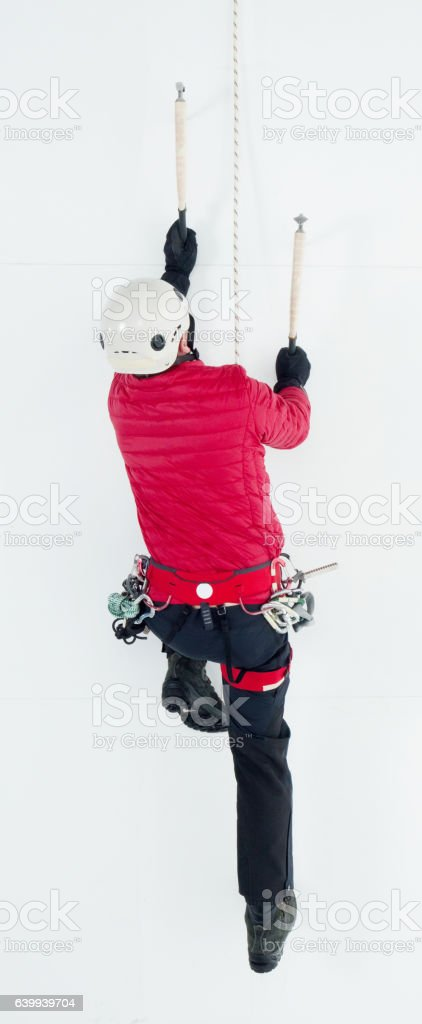 Above view of male climber climbing up stock photo