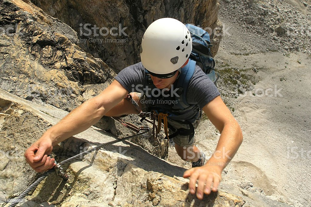 Above view of male rock climber with safety helmet stock photo