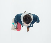 Above view  of man holding shopping bag