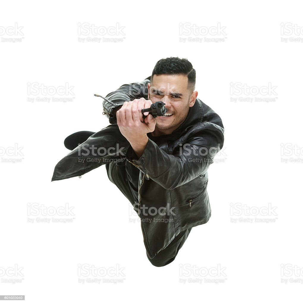 Above view of man in action with gun stock photo