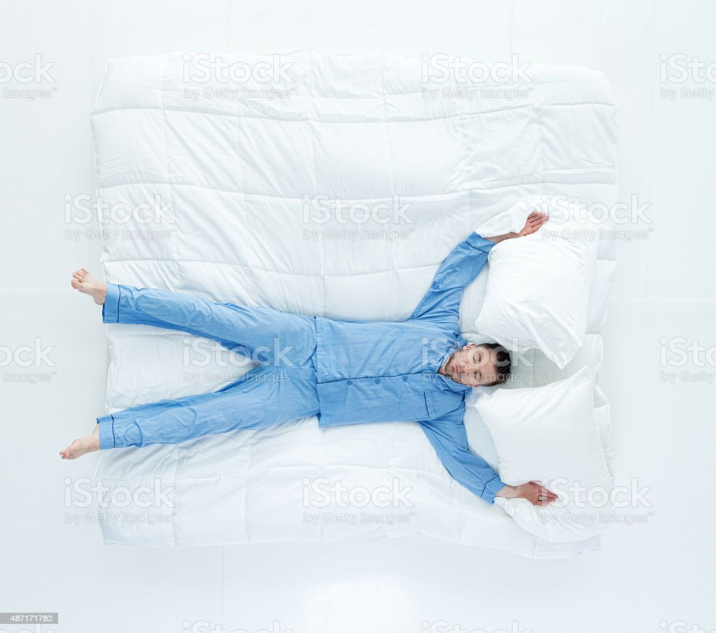 Above view of man sleeping on bed stock photo