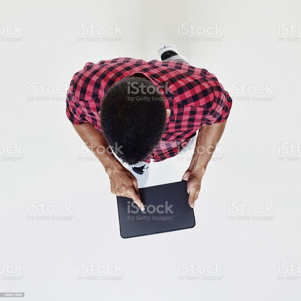 Above view of man using tablet royalty-free stock photo