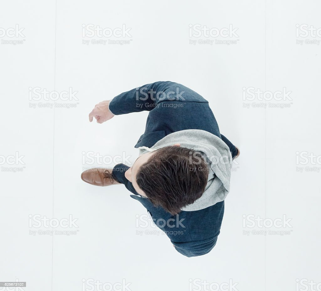 Above view of man walking stock photo