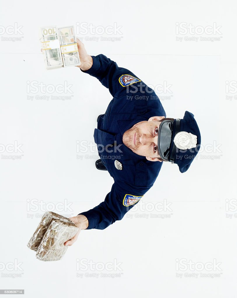 Above view of police holding drug and money stock photo
