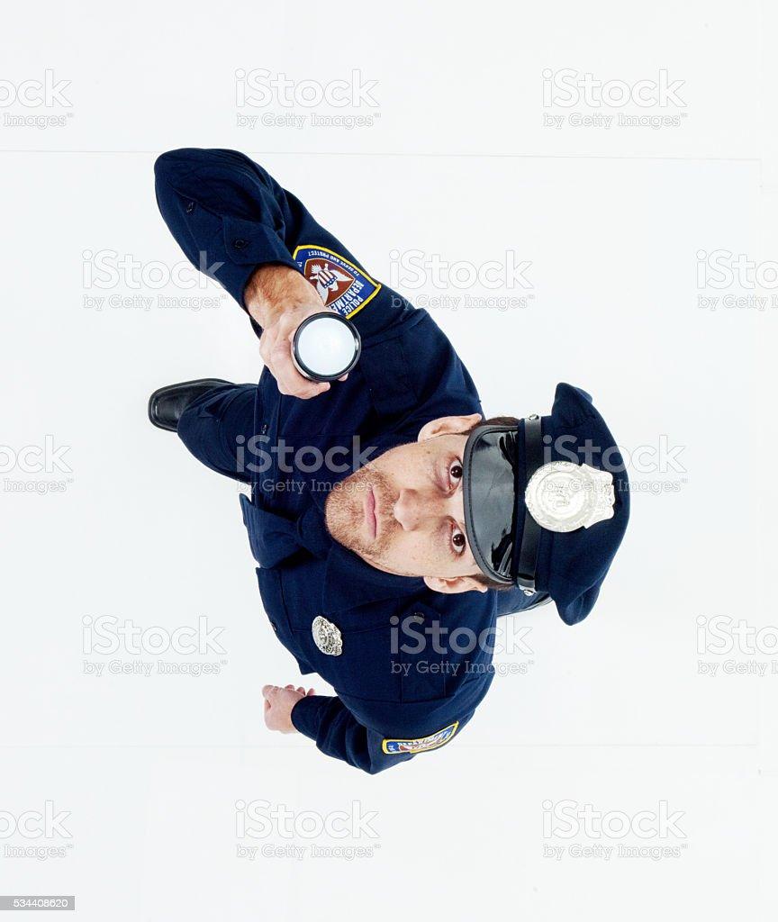 Above view of police in action with flash light stock photo