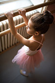 Above view of small ballerina at ballet dance studio.