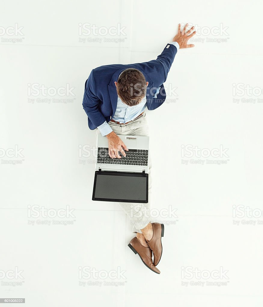 Above view of smart casual man typing on laptop stock photo