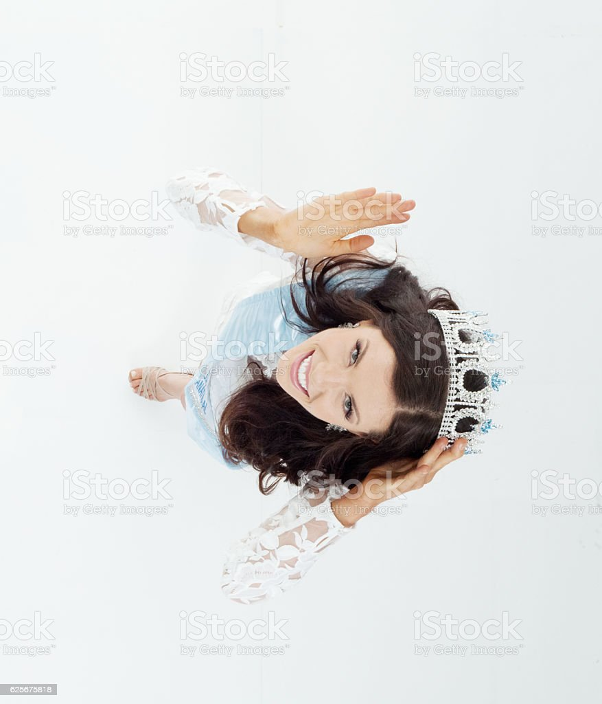 Above view of smiling beauty queen waving hand stock photo