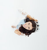 Above view of smiling beauty queen waving hand