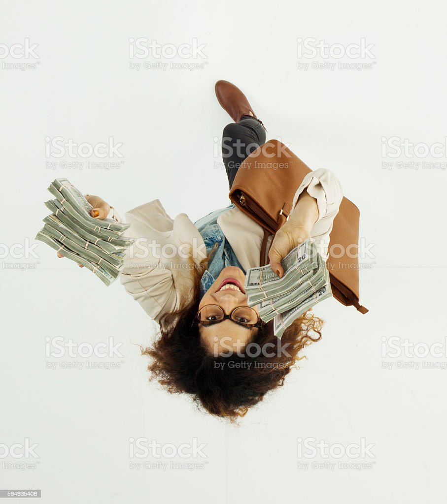 Above view of woman excited by money stock photo