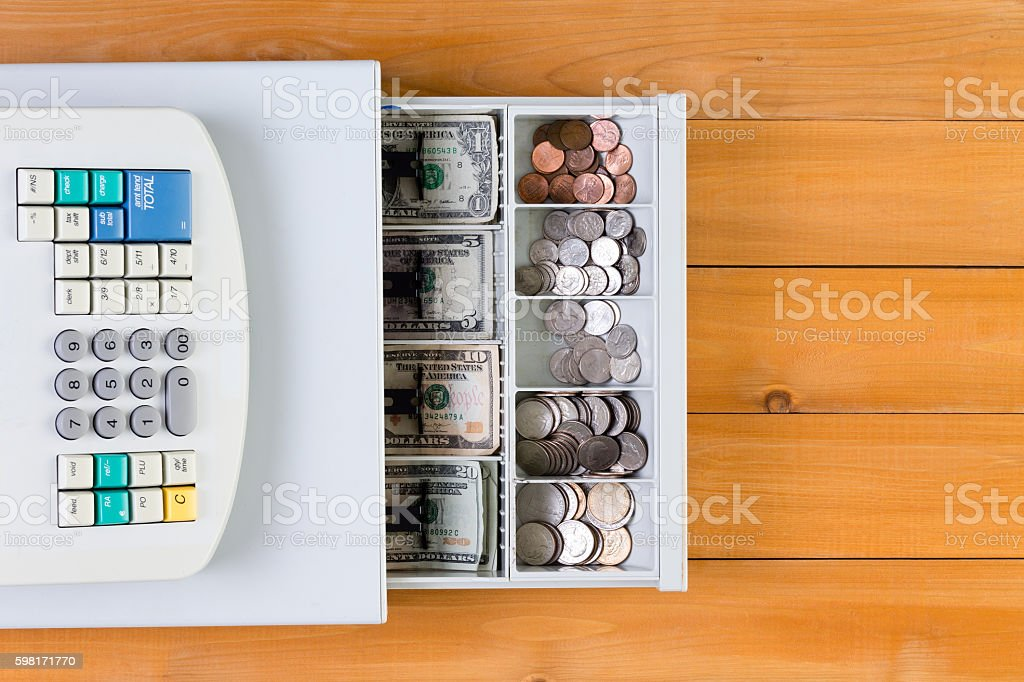 Above view on cash register full of coins stock photo