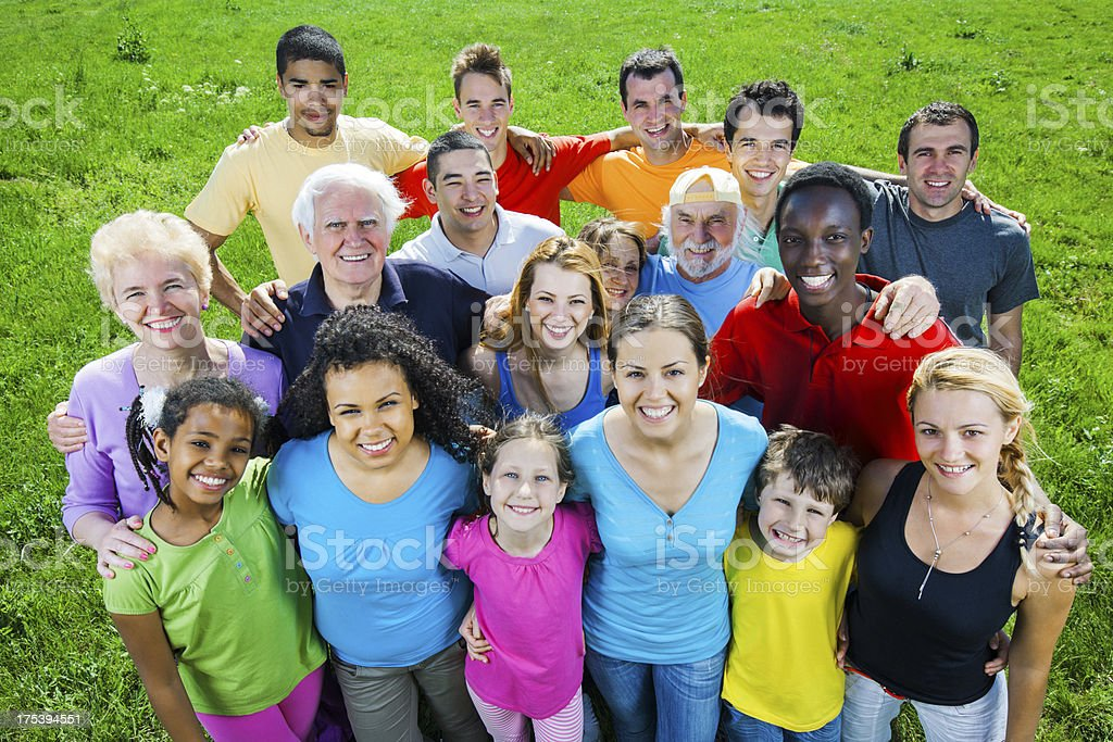 Above view.Large group of embraced people in nature. royalty-free stock photo