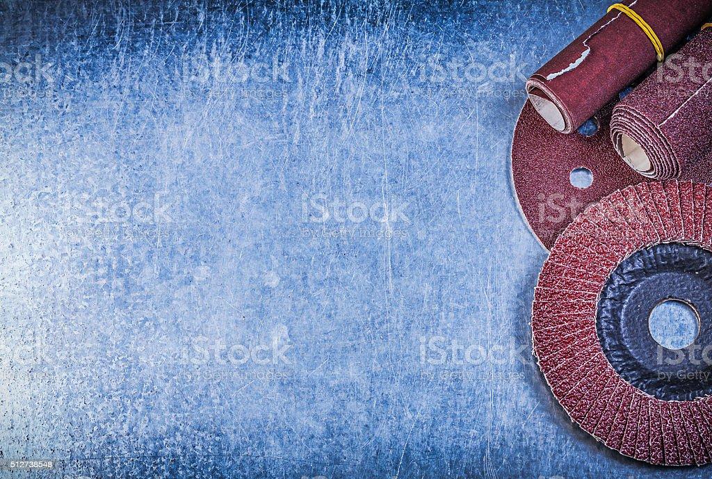 Abrasive flap wheel grinding disc emery paper rolls on metallic stock photo