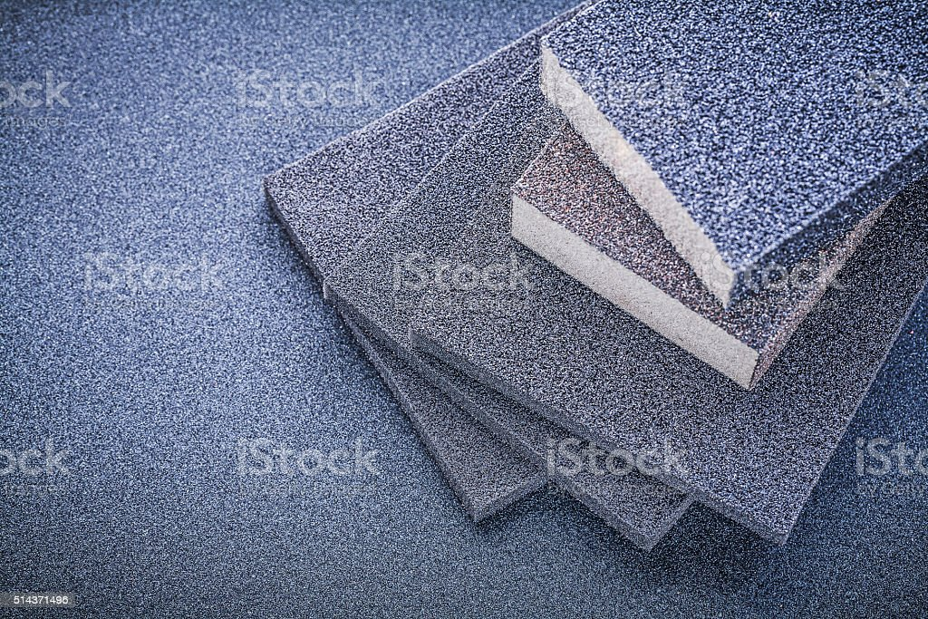 Abrasive sponges for grinding on emery paper top view stock photo